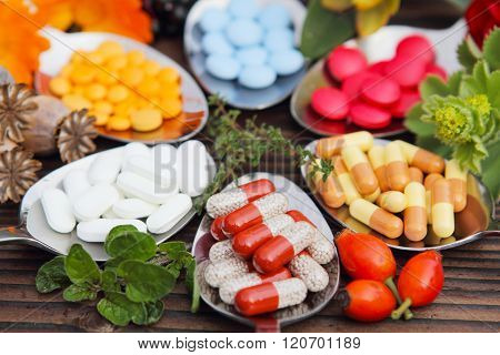 Pills tablets capsules and medicinal herbs