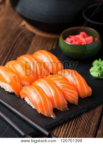 Sushi with salmon served on black stone