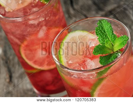 Close-up Red Cocktail With Ice, Lime And Mint