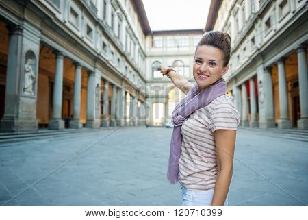 Woman Tourist Pointing On Uffizi Gallery In Florence, Italy