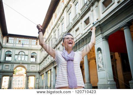 Happy Woman Tourist Rejoicing Near Uffizi Gallery, Florence
