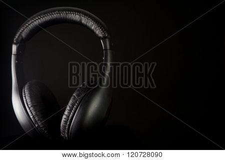 Headphones on a black