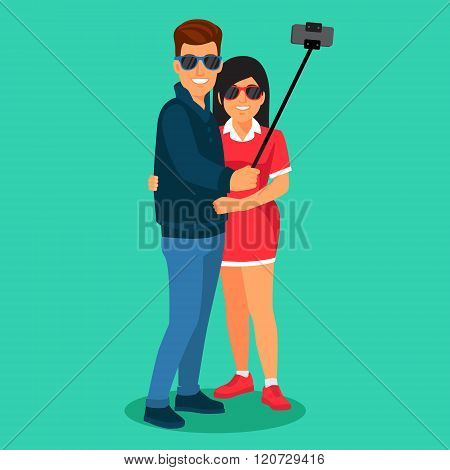 Couple photographing themselves on selfie stick