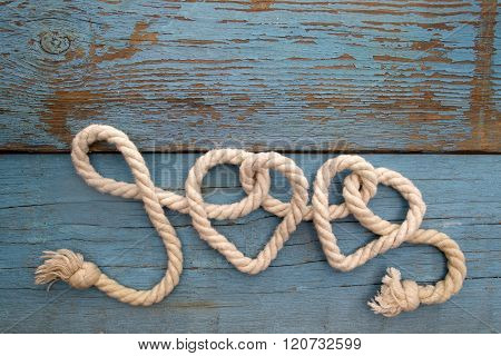 leash  rope into heart shape on wood