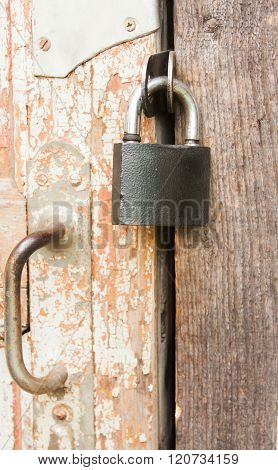 Hanging Lock On An Old Wooden Door