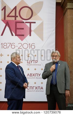 ST. PETERSBURG, RUSSIA - FEBRUARY 25, 2016: President of Academy Alexey Talashchuk (right) and acting rector Vasily Kichedzhi at the celebration of 140th anniversary of Stieglitz Academy