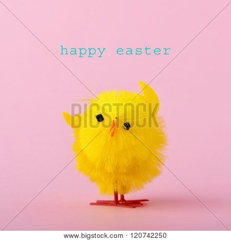 a colorful yellow teddy chick and the text happy easter against a pink background
