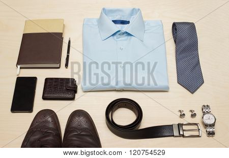 Men's classic outfit with blue shirt, tie and accessories