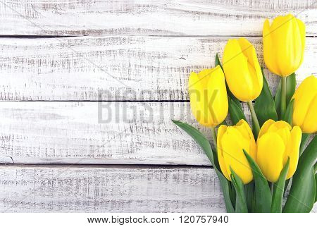 Bouquet Of Yellow Tulips On White Rustic Wooden Background. Spring Flowers. Spring Background. Valen