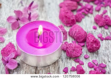 a  pink Candle decorative stones flowers spa