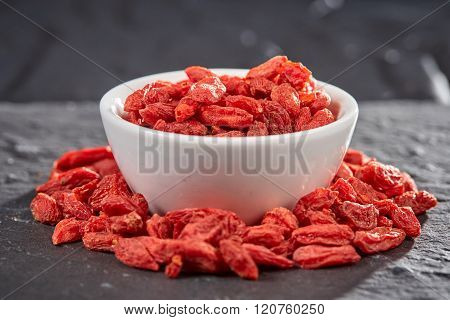 Red Goji Berries In Bowl On Stone Plate