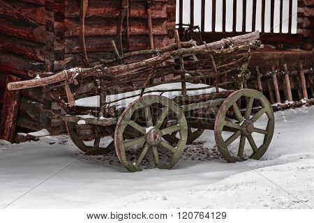 old wooden cart to transport firewood. Horizontally