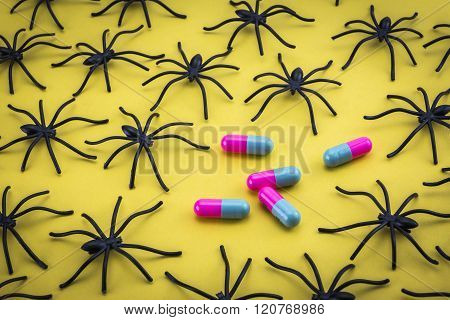 Spiders Around Capsules On Yellow Background, Concept Phobia To Medicines