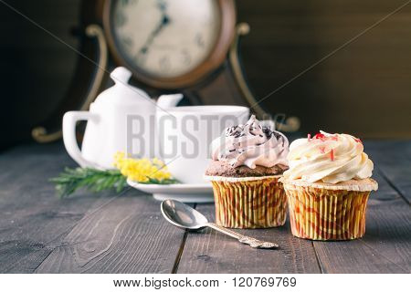 Cupcakes And Cup Of Tra On Dark Wooden Background