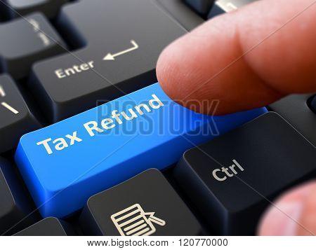 Press Button Tax Refund on Black Keyboard.