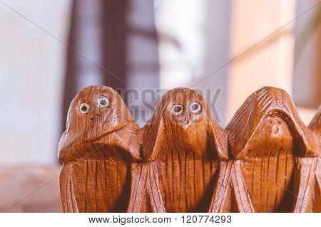 Three monkeys hear see and speak no evil poster