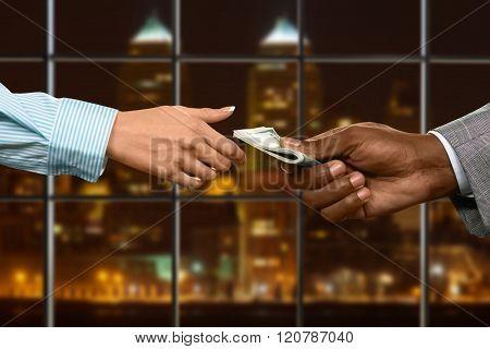 Businesswoman loans money in office.