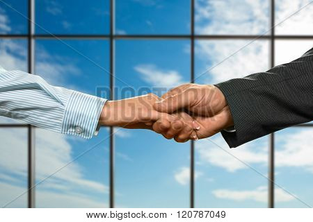 Business couple's handshake beside window. Business handshake on sky background. Protection and trust. Our new ally. poster