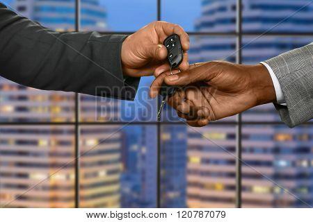Clerk gives car key.