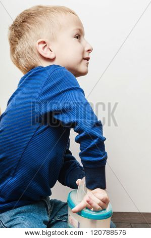 Little Boy Help Parent Cook In Kitchen.