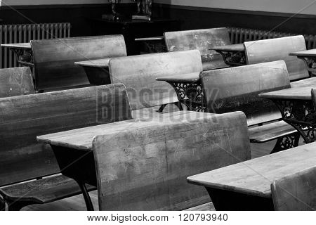 These antique desks still sit in rows waiting for the long gone students to return at the Lunenburg Academy in Nova ScotiaCanada