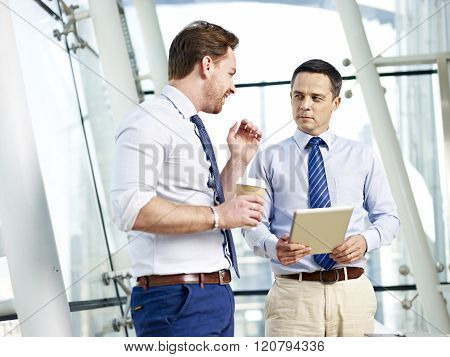 Businesspeople Discussing Business In Office