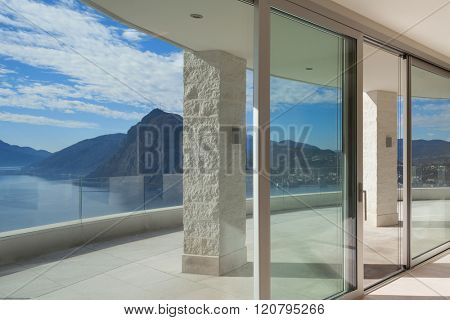 Interior of a penthouse, room with big windows, panoramic terrace