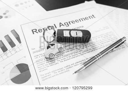 Signing car rental agreement contract