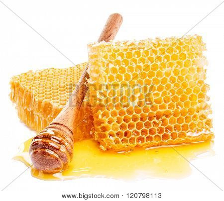 Honeycomb and honey drizzler on a white background.  High-quality picture.