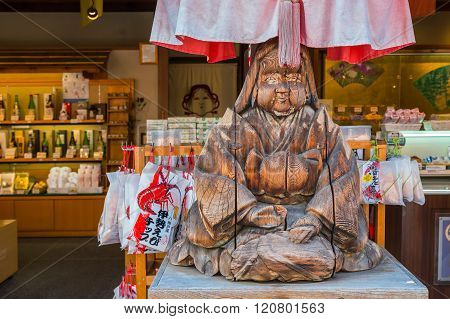MIE JAPAN - NOVEMBER 20 2015: Wood sculpture of Japanese priestess at Oharai-machi is the old-800 meter long pilgrimage road that leads to Ise Jingu inner shrine with traditional Edo architecture style
