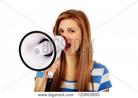 Teenage woman screaming through megaphone