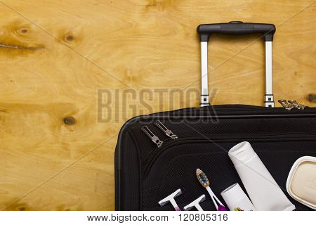 Suitcase Traveler And Toiletries.
