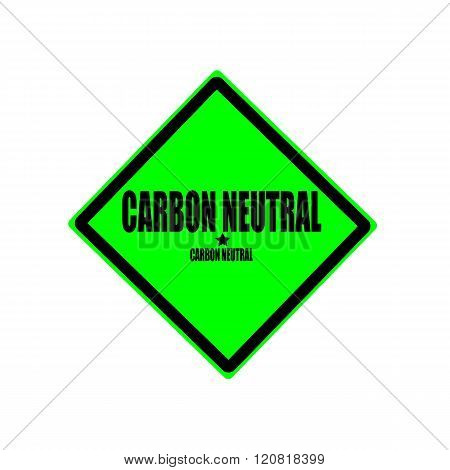 CARBON NEUTRAL black stamp text on green background