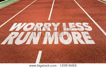 Worry Less Run More written on running track