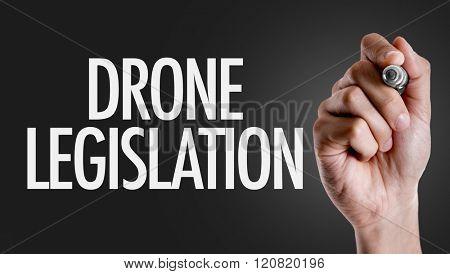 Hand writing the text: Drone Legislation