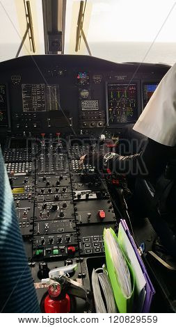 Pilot and copilot in corporate plane in cockpit, Pilot operation with control panel.