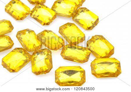 Yellow  rhinestone on white background . poster