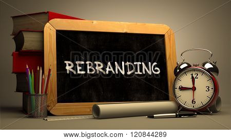 Rebranding Handwritten by white Chalk on a Blackboard.
