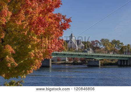 Bright Red-Orange Leaves Overlooking River