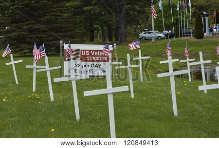 Bangor, Maine/USA-May 25: A makeshift display at the Mount Hope Cemetery on Memorial Day, May 25, 2015, bringing awareness to the problem of military veteran suicides.