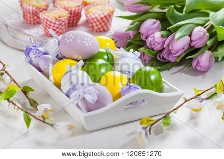 Easter table setting with painted eggs