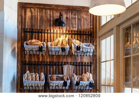 Variety of fresh baked bread in bakery shop. Gourmet breads for sale.