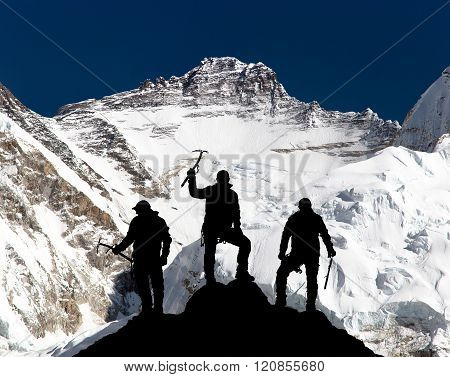 Mount Lhotse And Silhouette Of Group Of Climbers