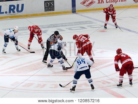 MOSCOW - JANUARY 15: A. Mereskin (25) on faceoff during hockey game Spartak vs Admiral on Russian KHL premier hockey league Championship on January 15 2016 in Moscow Russia. Spartak won 5:4