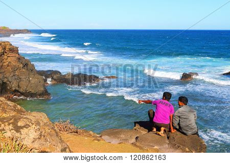 GRIS-GRIS, MAURITIUS ISLAND - 1. NOVEMBER, 2015: Unidentified tourists on sea cliff where the constant squashing of waves against the flanks of the cliff gives the impression that the cliff is crying.