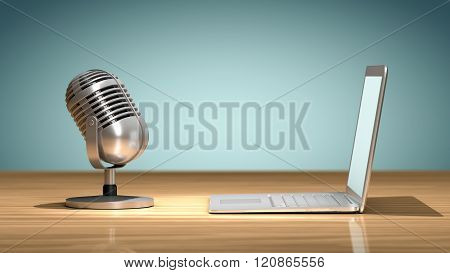 Vintage microphone in front of a laptop