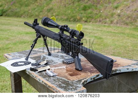 Weapon And Target Sign On A Table
