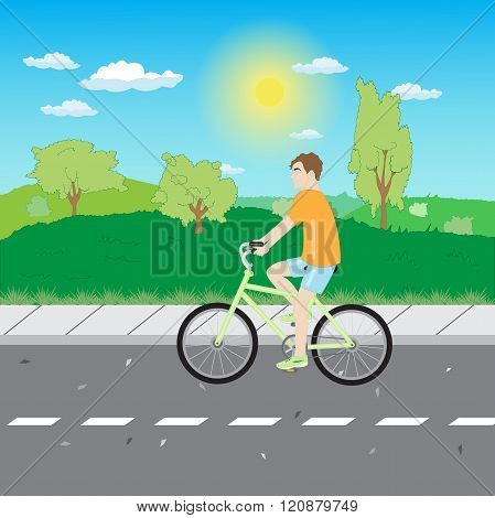 A Man Riding A Bicycle On The Road