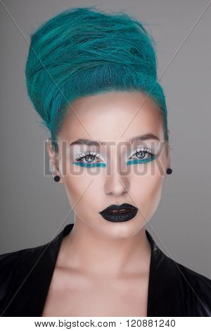 creative and futuristic look of fashion woman with green hairstyle