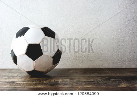 Old Soccer football on wood